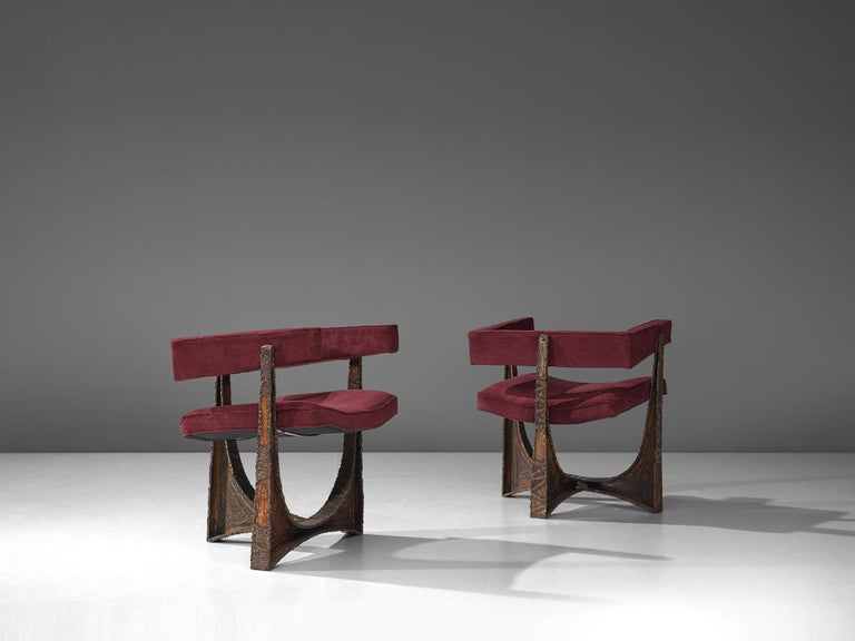 Paul Evans, pair of armchairs, steel and upholstery, United States, 1960s  A rare pair of highly sculptural armchairs by Paul Evans. The base consists of a torch-cut, welded, polychromed and patinated steel as the foot. The base flows over in a