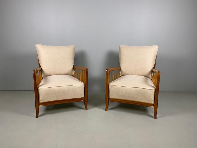 Paolo Buffa (1903-1970). Handsome pair of cherrywood stained armchairs with spindled back and arms, sculpted armrests and tapered legs,