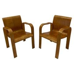 Rare Pair of Sleek Molded Plywood Mid-Century Modern Armchairs