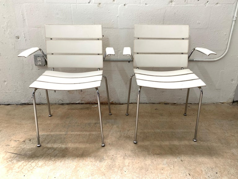 Pair of rare chairs rendered in white stitched leather seat, back, and arms with chrome-plated steel frames designed by Giancarlo Vegni for Fasem, made in Italy, 1999.
