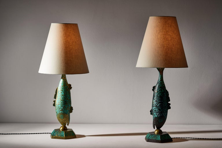 Rare pair of table lamps by Pepe Mendoza. Designed and manufactured in Mexico, circa 1950s. Brass with ceramic inlay and custom linen shades. Rewired for U.S. standards with black French twist cord. We recommend one E27 75w maximum bulb per light.