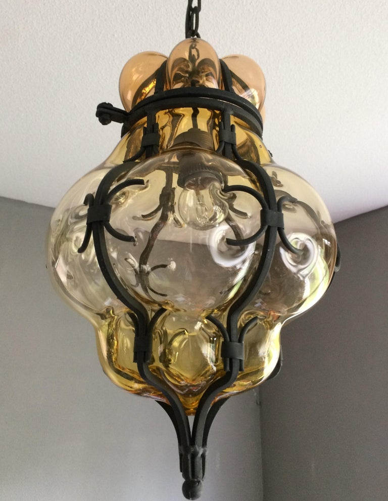 Italian Rare Pair of Venetian Mouth Blown Amber Glass in Wrought Iron Frame Pendants