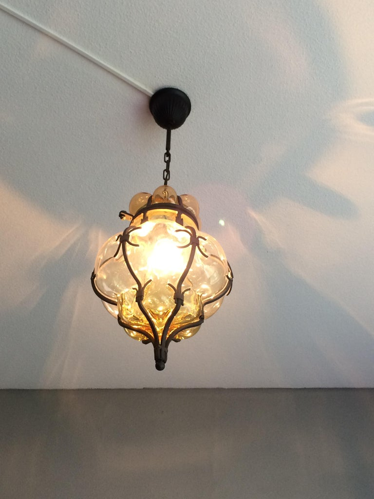 Rare Pair of Venetian Mouth Blown Amber Glass in Wrought Iron Frame Pendants In Excellent Condition In Lisse, NL