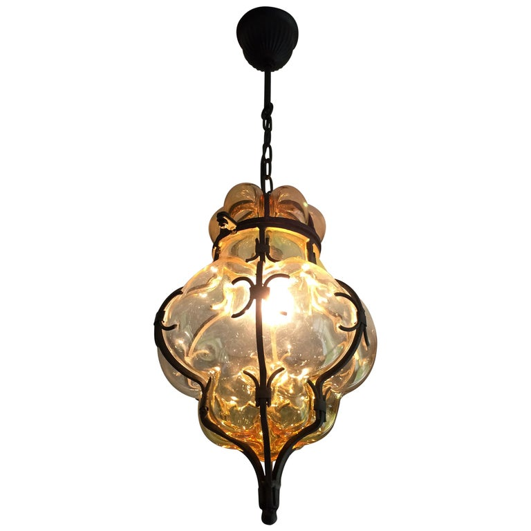 Rare Pair of Venetian Mouth Blown Amber Glass in Wrought Iron Frame Pendants