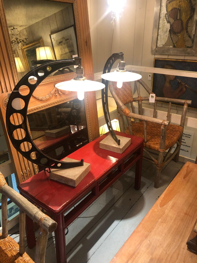 Extraordinary one of a kind pair of custom industrial table lamps having crescent shaped sculptural bodies constructed from micrometer measuring devices. Each is mounted to a square wooden base, and fabulous 10