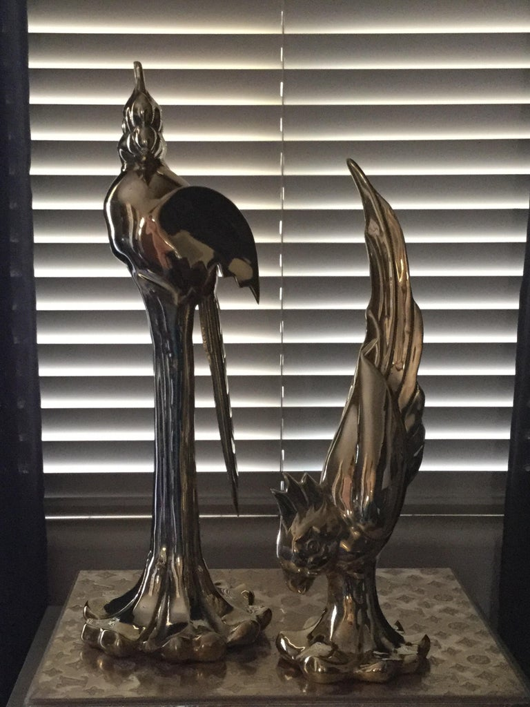 Beautiful pair of large brass parrots by Dolbi. 1980s. Rare and very collectible. Newly polished. Smaller parrot: 18