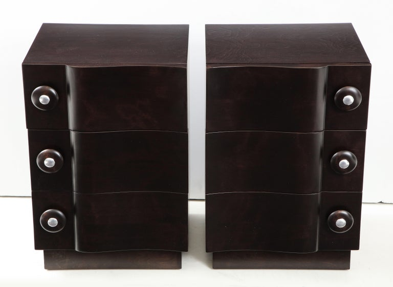 Wonderful pair of rare wave front cabinets / nightstands by James Mont. The cabinets have been totally restored in a beautiful ebonized finish.