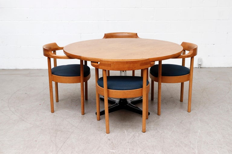Rare midcentury Pastoe round oak dining or center table with chrome and enameled metal pedestal base. Lovely subtle contrasting inlaid detail on the top. Lightly refinished with some wear consistent with its age and use. Shown with set of 4 Henning