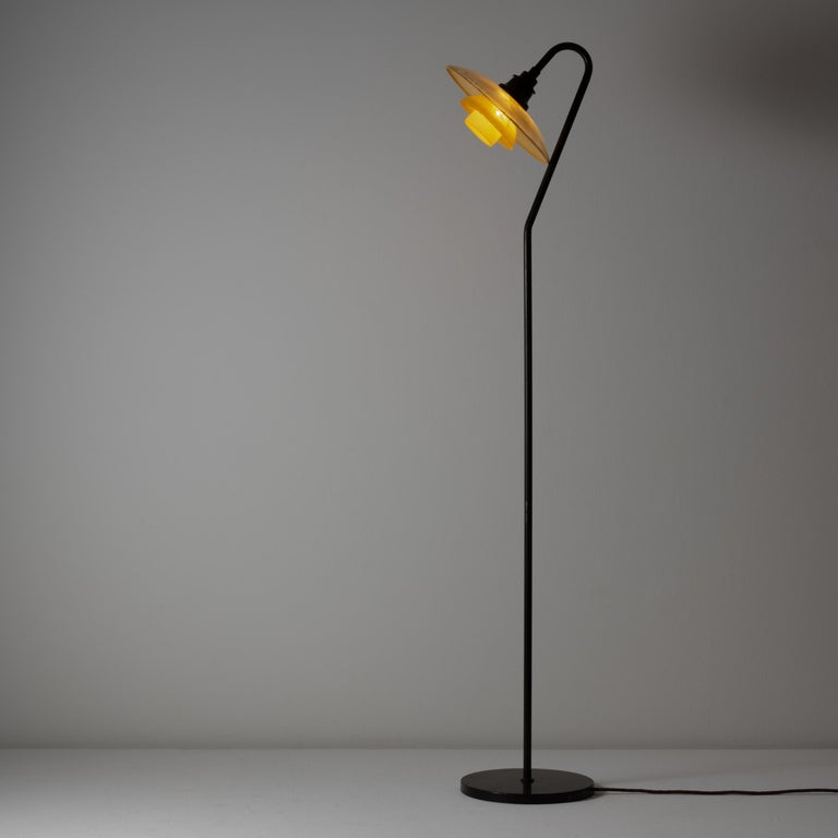 Rare PH 3/2 Floor Lamp by Poul Henningsen. Designed and manufactured in Denmark, 1931. Amber glass shade with original stamp, metal base and stem, original cord. We recommend one E27 100w maximum bulb. Bulbs not provided.