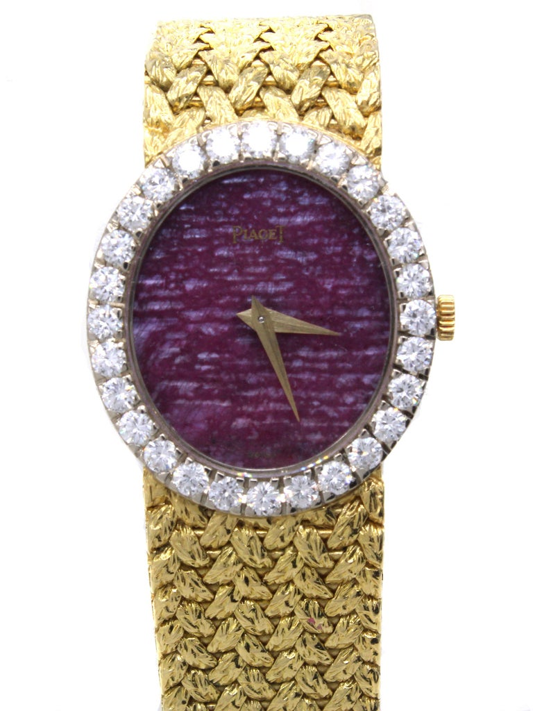Rare Piaget Ruby Dial Diamond 18 Karat Gold Mechanical Wristwatch In Good Condition For Sale In New York, NY