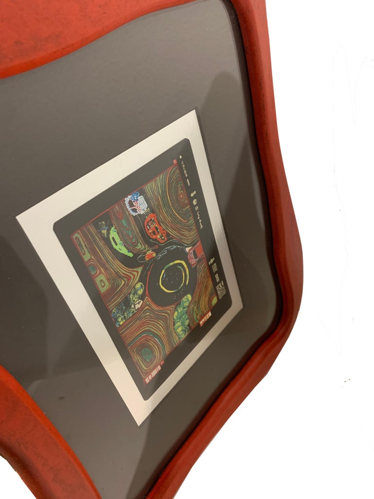 A beautiful and rare print in its original biomorphic wood red frame, circa late 1980s, in great condition. The print is in excellent condition, images show reflection which we could not avoid.