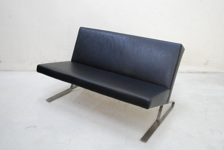 Model Satyr designed by ForUse.  Manufactured by Classicon. This object is a rare and unique prototype from the pre production with a raw steel base from the year 2005. The cover is a black faux leather.