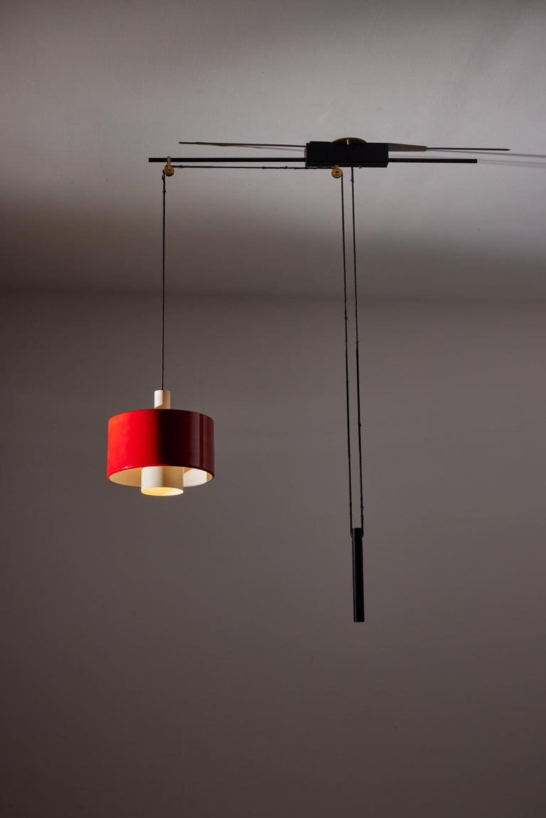 Rare Pulley suspension light by Gaetano Sciolari for Stilnovo. Designed and manufactured in Italy, circa 1950's. Enameled metal, custom brass ceiling plate, solid brass pulley. Rewired for U.S. standards. We recommend one E27 75w maximum bulb. Bulbs