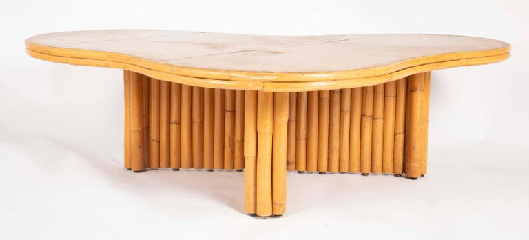 A beautiful rattan coffee table with removable top attributed to Paul Frankl. Interesting form. Very rare.