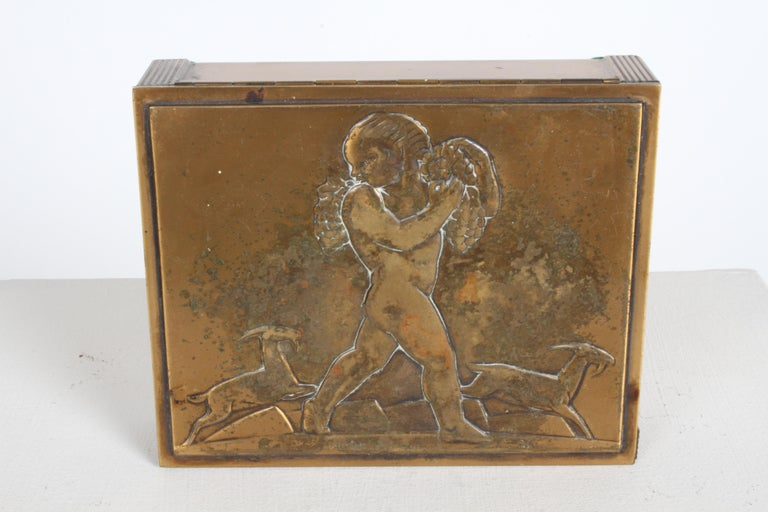 Rockwell Kent (American, 1882-1971) Rare Bacchus Art Deco copper cigarette box for Chase Chrome & Brass company, only offered in 1935 and 1936.   Rockwell Kent designed only three items for chase, all with the same young Bacchus motiff, and all