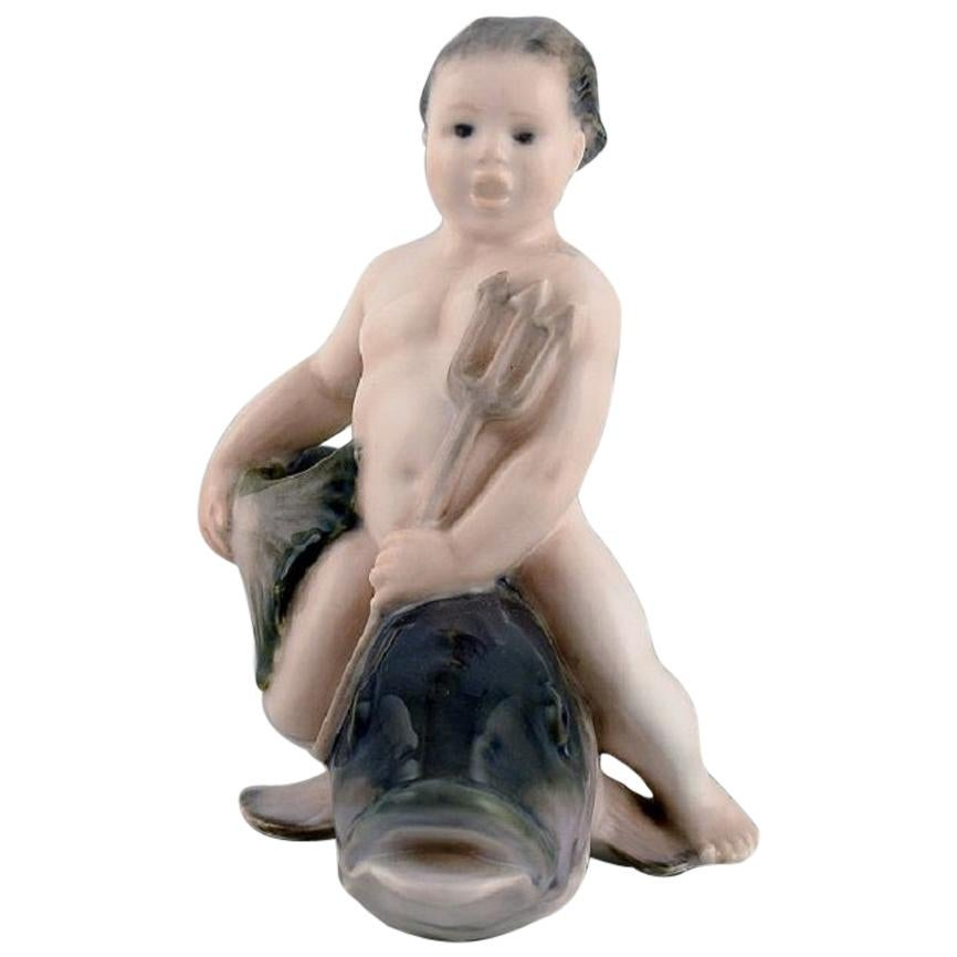 Rare Royal Copenhagen Porcelain Figurine, Boy Sitting on a Fish, 1920s