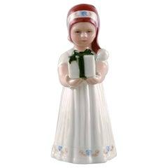 Rare Royal Copenhagen Porcelain Figurine, Girl with Christmas Present