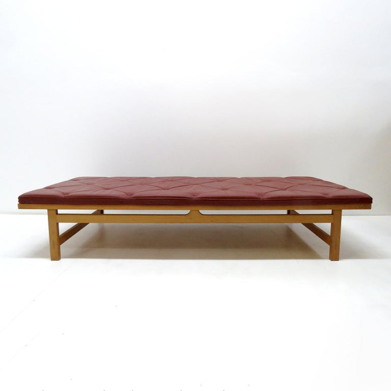 Stunning, rare daybed designed by Rud Thygesen & Johnny Sørensen for Botium in 1989, frame in cherrywood with French wicker backing and a red, maroon/burgundy colored tufted leather seat cushion, part of the 'King' series designed in 1969 as gifts