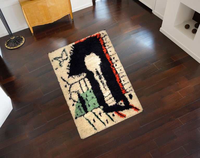 Rare rug designed by Pablo Picasso Title: La Serrure Year: circa 1955 Material: Wool Dimensions: 200 x 154 cm / 6.56 x 5.1 ft. Edition 1/1  Pablo Picasso, the Spanish painter, sculptor, printmaker, ceramicist, stage designer, poet and playwright is
