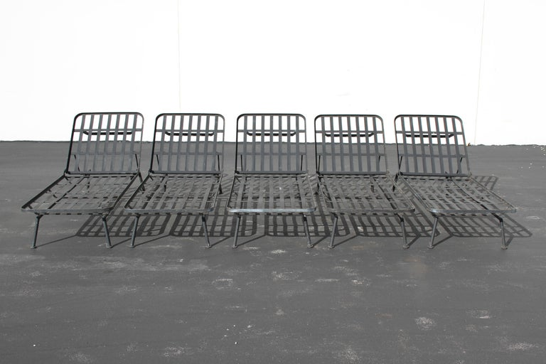 Five Russell Woodard wrought iron adjustable chaise loungers or daybeds, sold individually. Cushions are missing, but can be fabricated for additional cost. Original paint, so items can be sandblasted, primed and painted for $275ea. Part of the