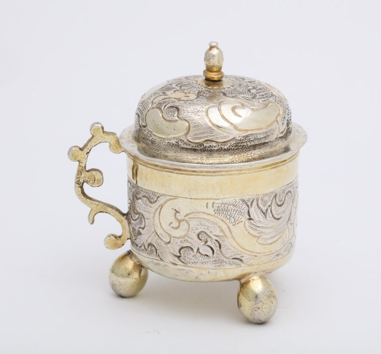 From the reign of Russian Empress Elizabeth Petrovna, this rare mid 18th century silver charka or drinking cup was made Grigorii Serebrianikov in the ancient capital of Moscow. The partially gilded cylindrical cup is decorated with scrolls and