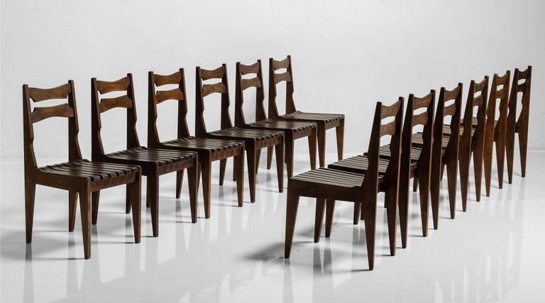 Rare set of 12 Guillerme et Chambron dining chairs, France, Circa 1950  Unique chairs with slatted seat and decorative backrest.