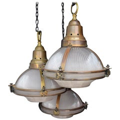 Rare set of 3 Holophane Glass Globe Pendant Lamps with brass fittings circa 1920