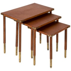 Rare Set of 3 Nesting Tables in Stitched Leather by Jacques Adnet