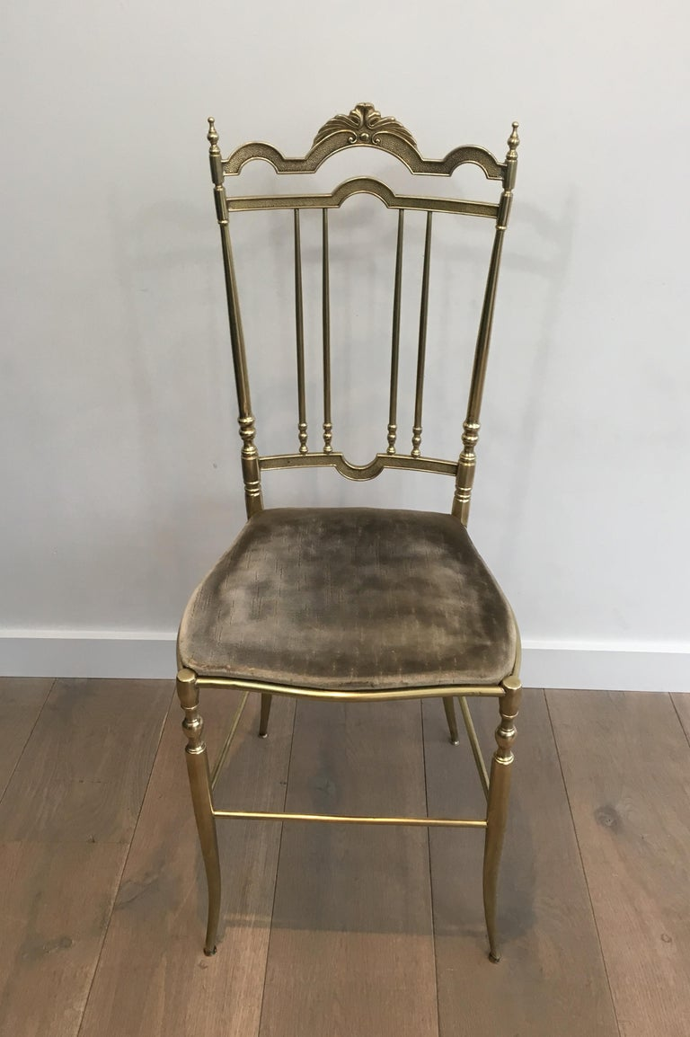 This rare set of 4 elegant neoclassical chairs is made of brass with a fabric seat (seats must be re-upholstered, what we could do with additional cost). This is a French work in the style of famous French designer Maison Jansen, circa 1940.