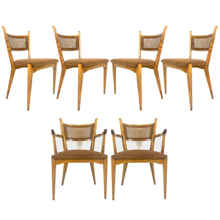 Set of six birch dining chairs by Edmond J. Spence This lovely original set consists of two armchairs and four side chairs. The chairs are in good original condition as shown. Caning is all in good condition as well. Lovely tweed upholstery on the