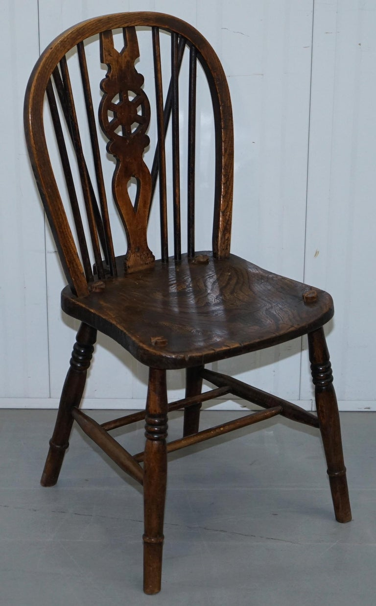 We are delighted to offer for sale very rare set of 6 original early Victorian elm windsor hoop back dining chairs, circa 1840  Its very rare to find a set of six, The chairs are hand carved from solid slabs of elm, the seat bases each have a