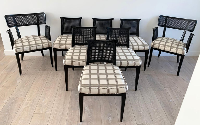 A stunning and increasingly rare set of 8 dining chairs by Edward Wormley for Dunbar. This set of 8 ebonized chairs features 2 model 4580 armchairs and 6 model 4632 side chairs. This incredible set came out of an estate in Beverly Hills from their