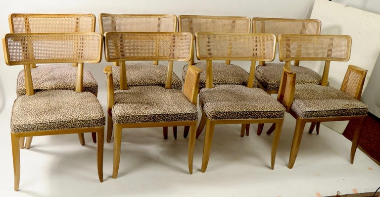 Rare set of 8 cane back dining chairs designed by Edward Wormley for Dunbar. This set includes 6 armless (model 4580) and 2 armchairs. The chairs are in original bleached mahogany finish, the seats were recovered by the original owner in the 1960s.