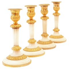 Rare Set of Four Almost Identicial Gilt Bronze Candlesticks with Marble Base