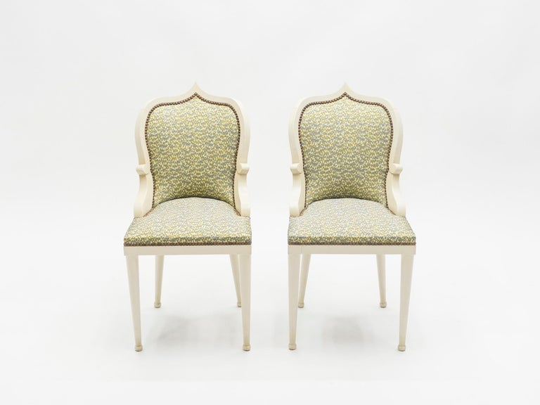 This is an incredibly rare set of 4 dining chairs by Elizabeth Garouste & Mattia Bonetti, model Palace, made in white cream painted solid oak. Garouste & Bonetti began their collaboration and gained global recognition for their interior design of