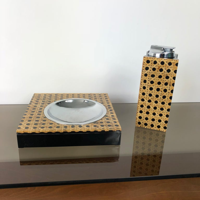 Rare set for smokers composed of a table-lighter and an ashtray designed by Felice Antonio Botta in the 1970s. Both the lighter and the ashtray have got the label. Measurements: Ashtray 17 x 17 x 3 cm, Lighter 17 x 6 x 6 cm.
