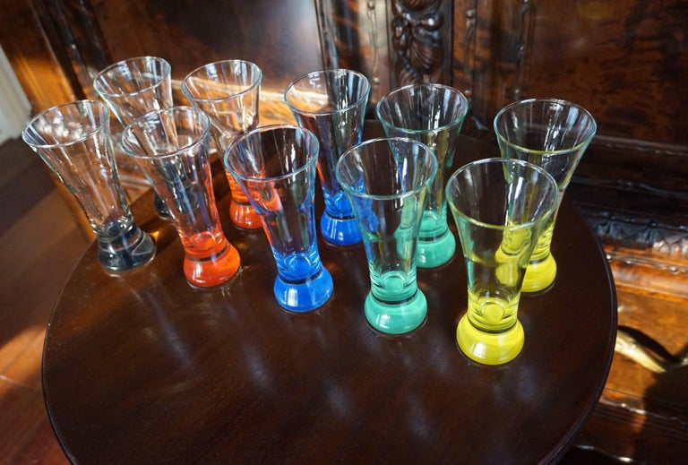 Museum quality and condition midcentury glasses.  You can regularly find the perfect midcentury drinks table, dresser or sidetable, but to find a set of 10 beautifully designed and handcrafted mid-century glasses in perfect condition is like the