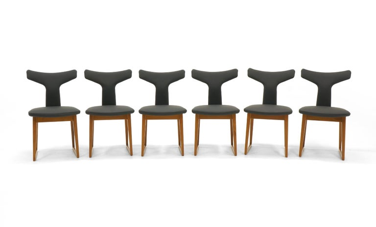 Very rare set of 6 dining chairs designed by Arne Vodder and made by Sibast, Denmark. Sibast was one of the finest makers of Danish modern design. We have fully restored this set including new black leather upholstery and expertly refinished teak