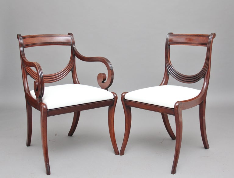 A rare and superb quality set of ten early 19th century mahogany sash back dining chairs, consisting of eight side chairs and two armchairs, with a nice reeded top rail and a unique reeded sash central rail, the armchairs having wonderfully shaped