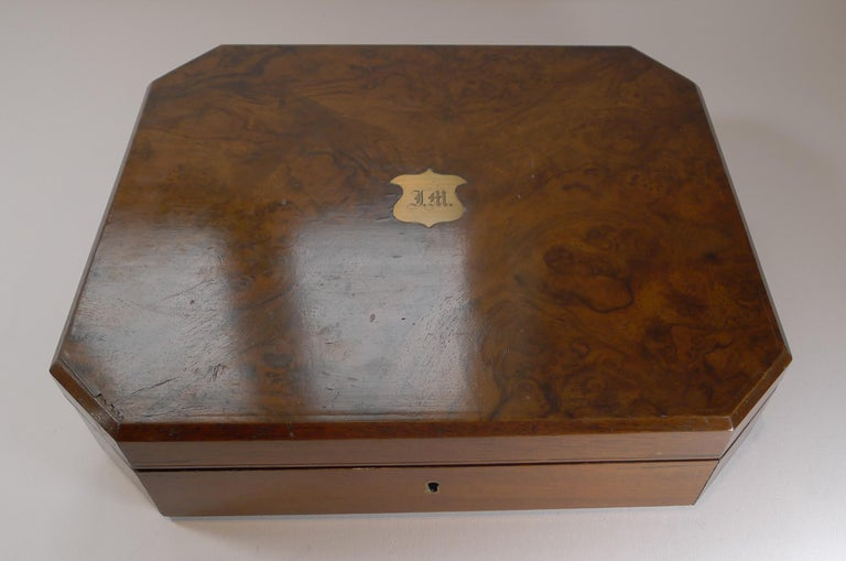 So rare to find a complete set for eighteen, in their top quality original presentation case made from Mahogany with the top veneered in lovely burl walnut, complete with it's original working key.  Both the silver plated knives and forks are