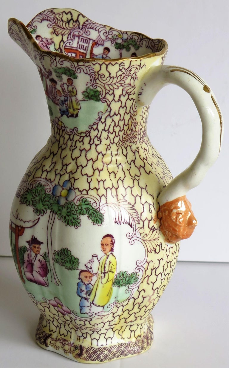 This is a superb Ironstone Jug or Pitcher made by the English Mason's Ironstone factory, dating to the late Georgian period, circa 1825.  The jug shape and pattern colorway are both rare.  The body is hexagonal in form, having a waisted central