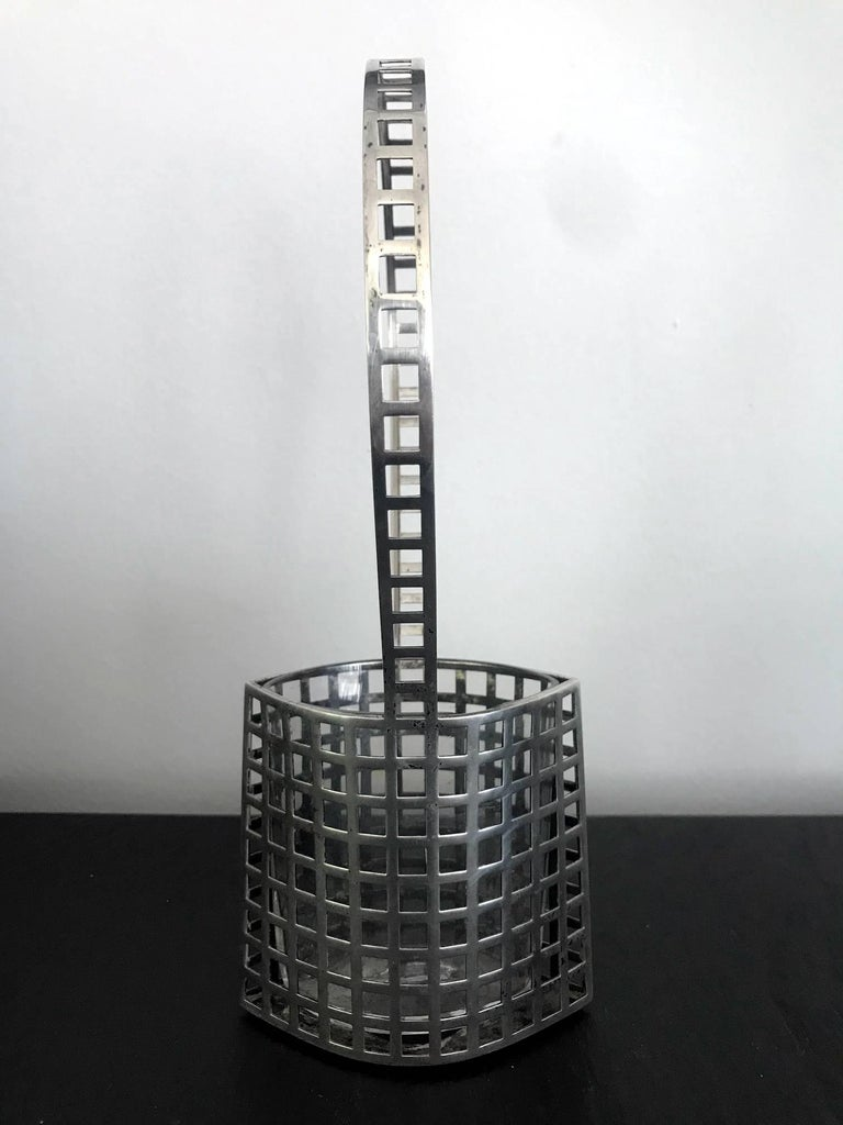 A Wiener Werkstatte silver reticulated flower basket with original glass insert in a very rare model made with silver. Designed by Josef Hoffmann (Austrian, 1870-1956), Vienna, circa 1906 and produced by the Wiener Werkstatte from 1906-1916 in