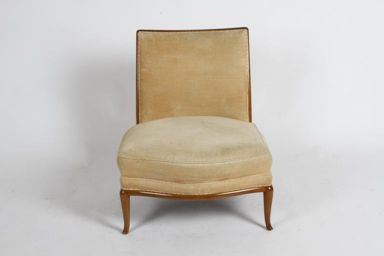 Beautiful French influenced design by T. H Robsjohn-Gibbings in original finish and re-upholstery. Serpentine front with elegant splayed legs on walnut frame, original finish shows scuffs. Price includes refinishing of wood, as original color or in