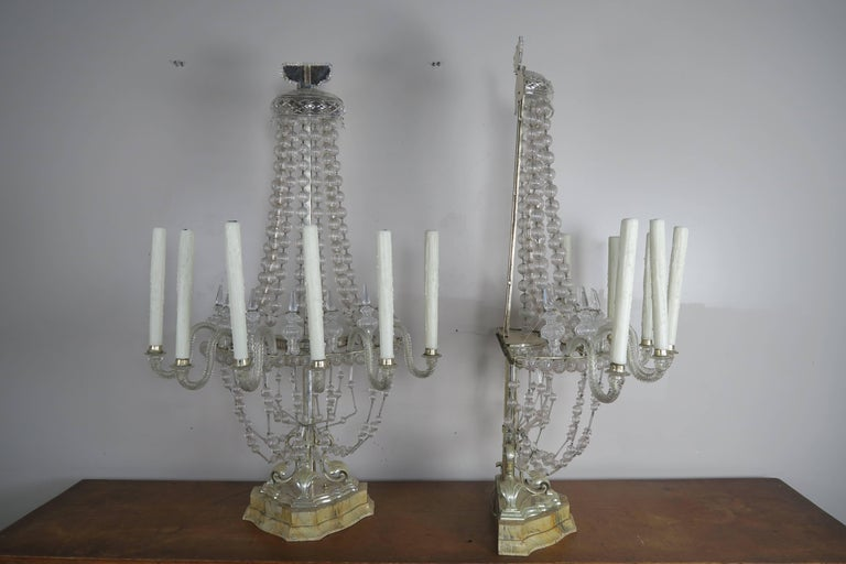 Pair of unique Venetian six-light monumental handblown Murano glass lamps made with garlands of handblown balls. The lamp sits on silver plated and faux painted marble bases. The lamps have been newly rewired with American sockets and are ready to