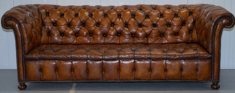 We are delighted to offer for sale this very rare fully restored circa 1860 hand dyed Whiskey brown leather Chesterfield sofa with original horse hair padding and coil sprung all over