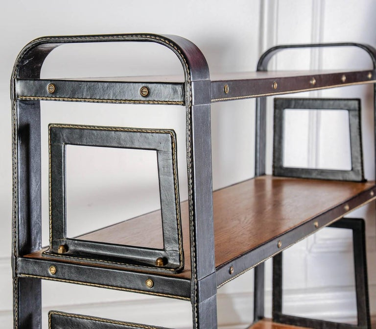 Mid-20th Century Rare Stitched Leather Bookcase by Jacques Adnet For Sale