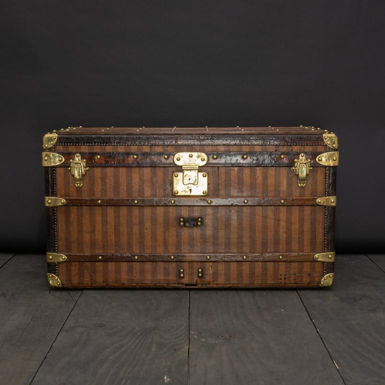 A rare Louis Vuitton striped canvas trunk with leather trim, brass fittings, single lock with key and re-lined interior to the lid, circa 1885.  Dimensions: 85 cm/33½ inches (length) x 49 cm/19¼ inches (depth) x 46 cm/18 inches (height).  Bentleys