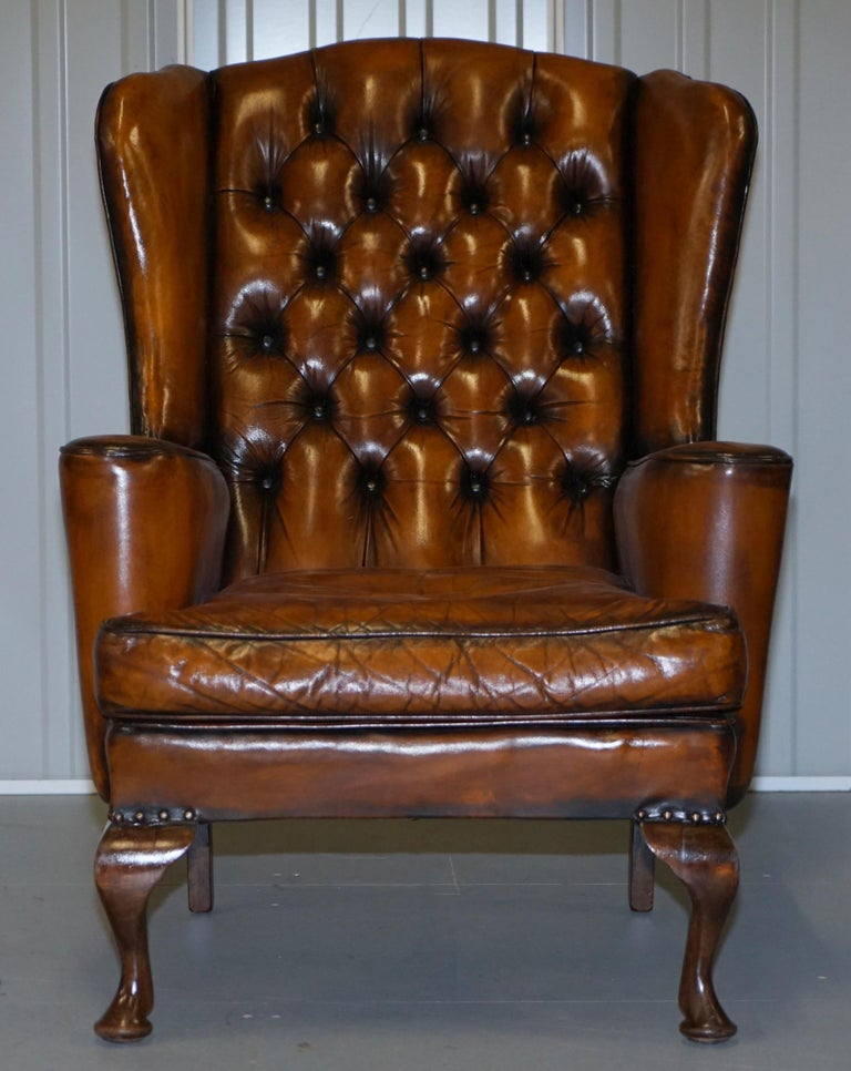 We are delighted to offer for sale this stunning fully restored Chesterfield Cigar brown leather wing back armchair with Morris style flat top arms  This is one of the nicer wing back chairs we have in stock, the colour is rich and has a wonderful
