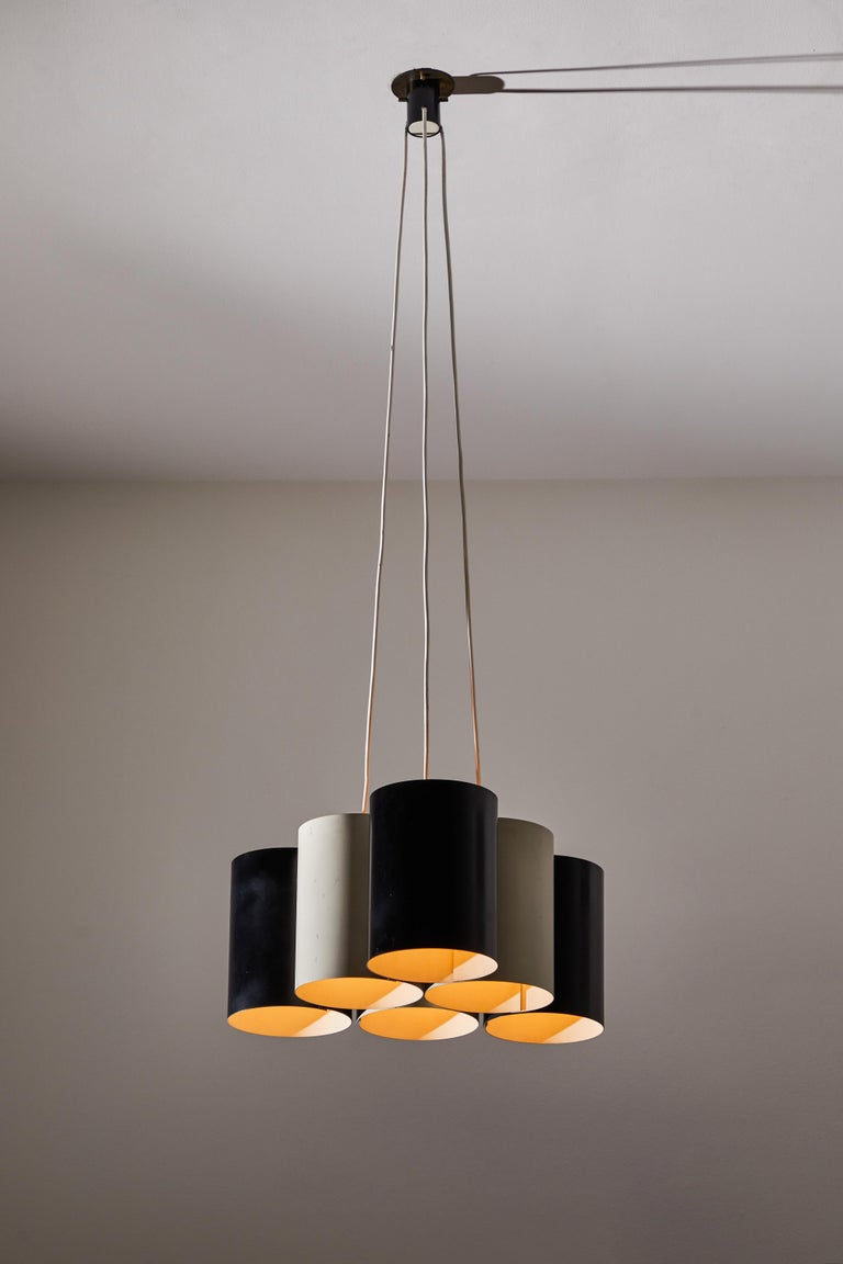 Rare suspension light by Stilnovo. Manufactured in Italy, circa 1960s. Rewired for U.S. junction boxes. Enameled metal. Custom brass ceiling plate. Takes six E27 40w maximum bulbs. Bulbs provided as a one time courtesy. Height displayed is the