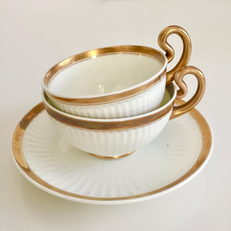 Welsh Swansea Porcelain Tea Set, Tea & Breakfast Cup White and Gilt, Regency ca 1820 For Sale